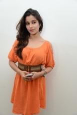 Actress Madhurima Cute in Orange Dress Photos Stills