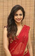 Rakul Preet Singh Spicy Hot in Red Saree Latest Photos at Tiger Audio Launch HD Stills