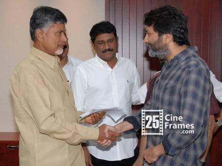 Trivikram hands over 10 Lakhs Rupees cheque to Chandrababu Naidu