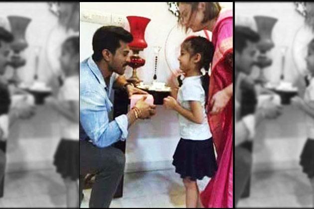 Pawan Kalyan's daughter ties Rakhi to Ram Charan!